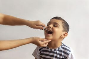 photo of child getting oral vaccine